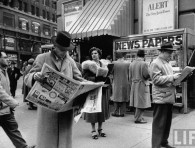 People buying out of town newspapers in Times Square during newspaper strike.December 1953.© Time Inc.Ralph Morse